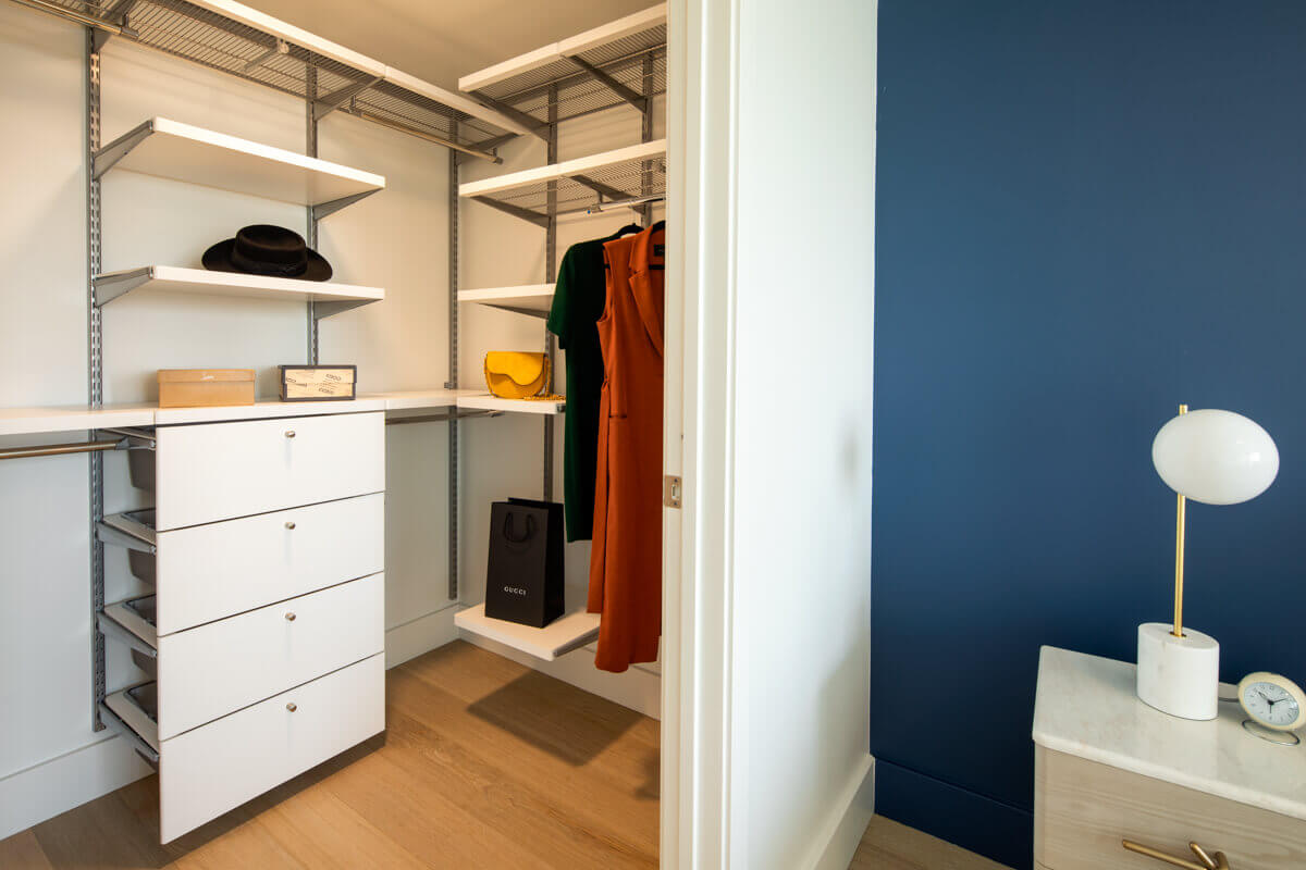 High Rise Apartments in DTLA - Park Fifth Tower Master Closet with Built-in Closet Organizer Featuring Drawers and Shelves