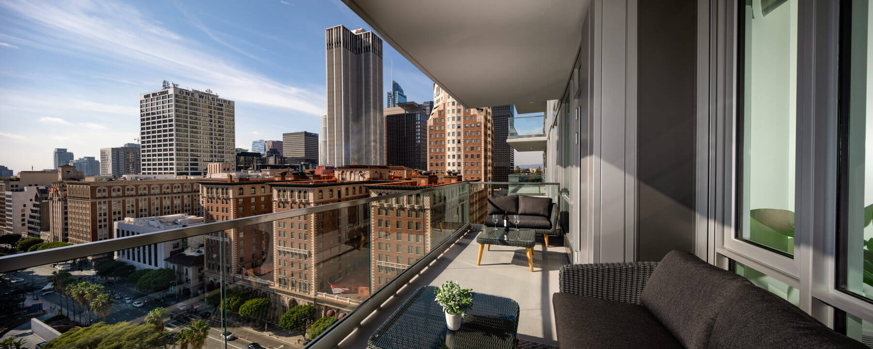 Pet Friendly Apartments in Downtown Los Angeles, CA - Park Fifth Tower Spacious Balcony with Glass Enclosure Overlooking Downtown Los Angeles