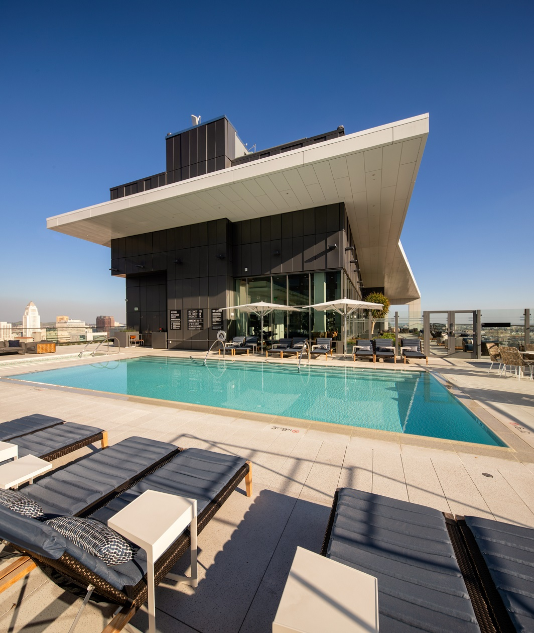 Luxury Apartments in Downtown Los Angeles for Rent - Park Fifth Tower Rooftop Pool with Lounge Chairs and Sweeping Views of DTLA