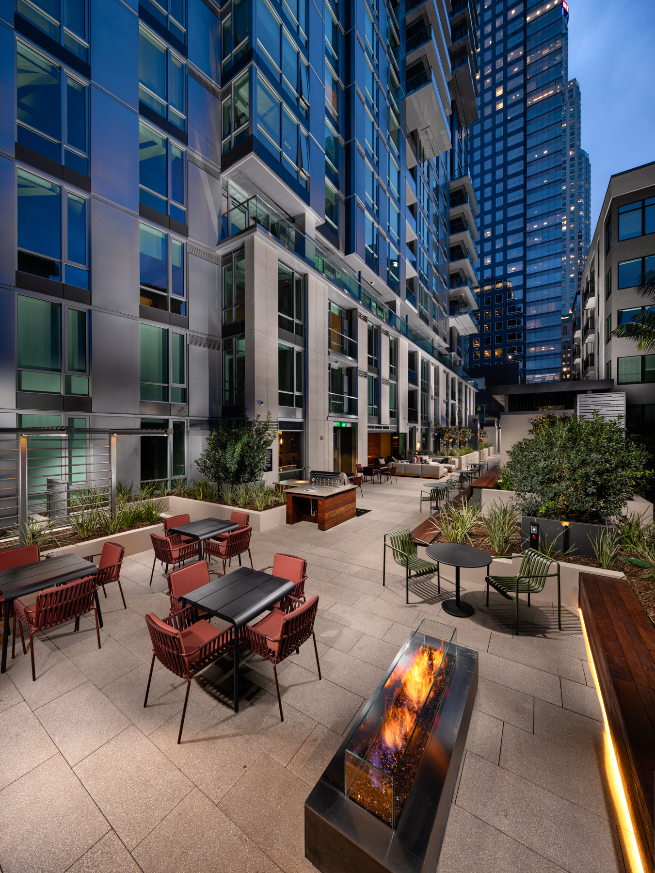 Luxury Apartments in Downtown Los Angeles, CA - Park Fifth Tower Outdoor Patio Lounge with Ample Seating, Fire Pit, and BBQ Grilling Area